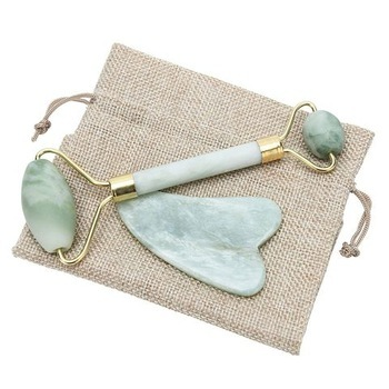 Gua sha and jade roller used to help treat and prevent acne by stimulating lymphatic drainage