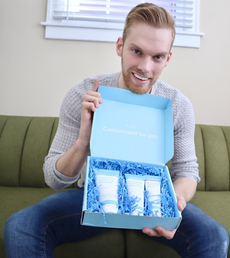 Man holding customized acne treatment kit from MDacne