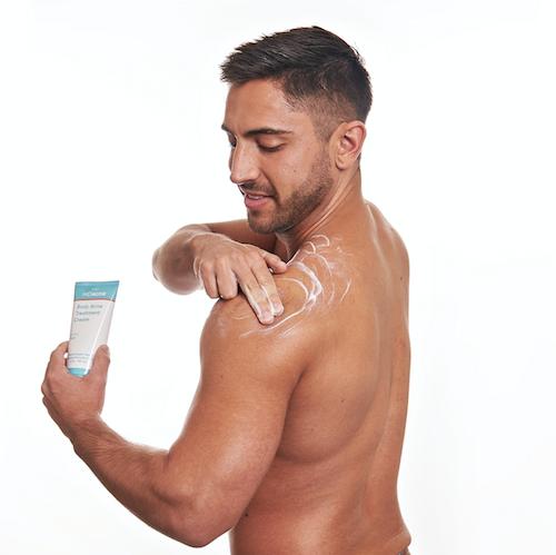 Man using MDacne body acne treatment cream