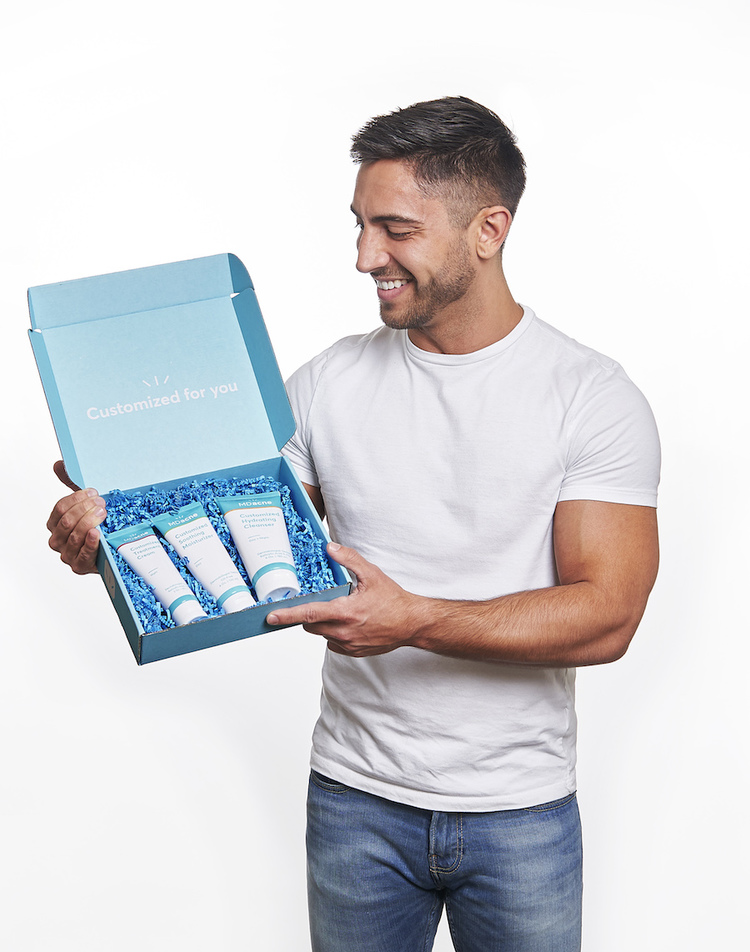 Man with MDacne's customized acne treatment kit