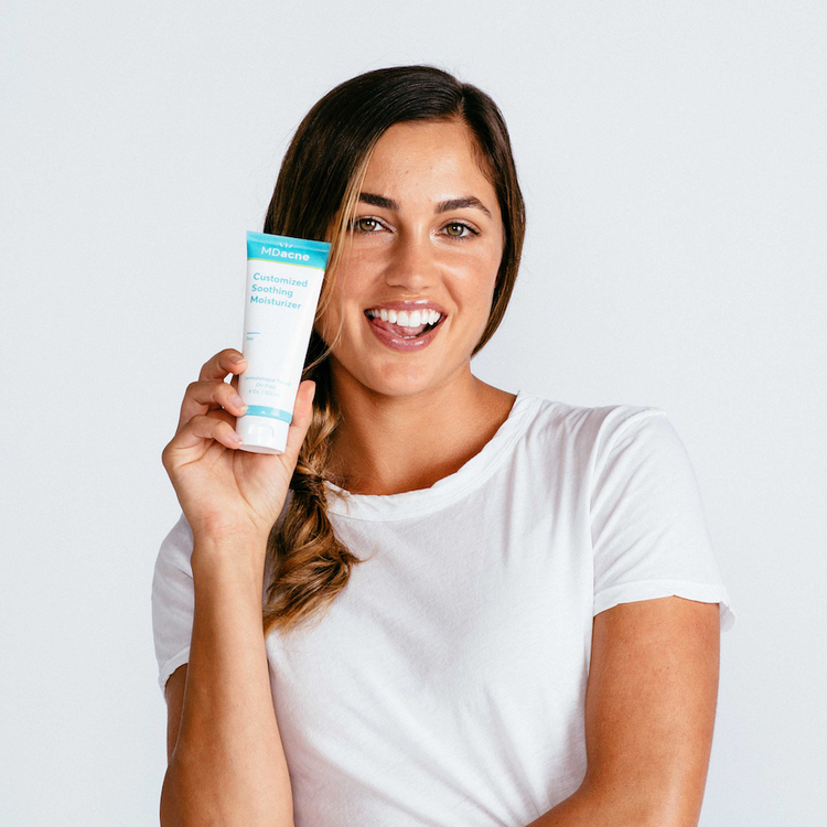 Woman using MDacne soothing moisturizer for acne-prone skin