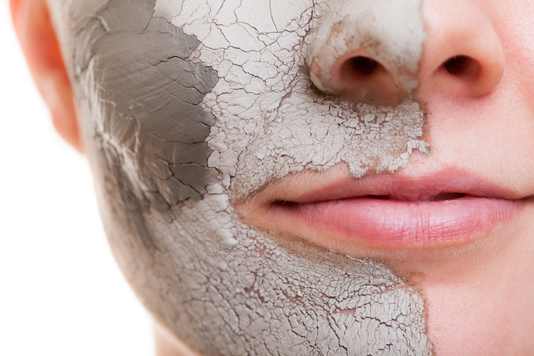 Man wearing bentonite clay face mask for acne treatment