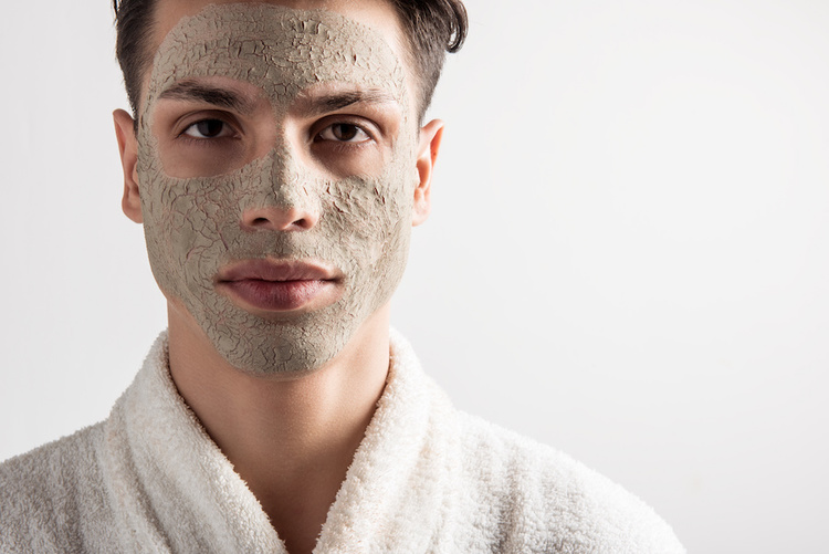 Man with a dry clay face mask