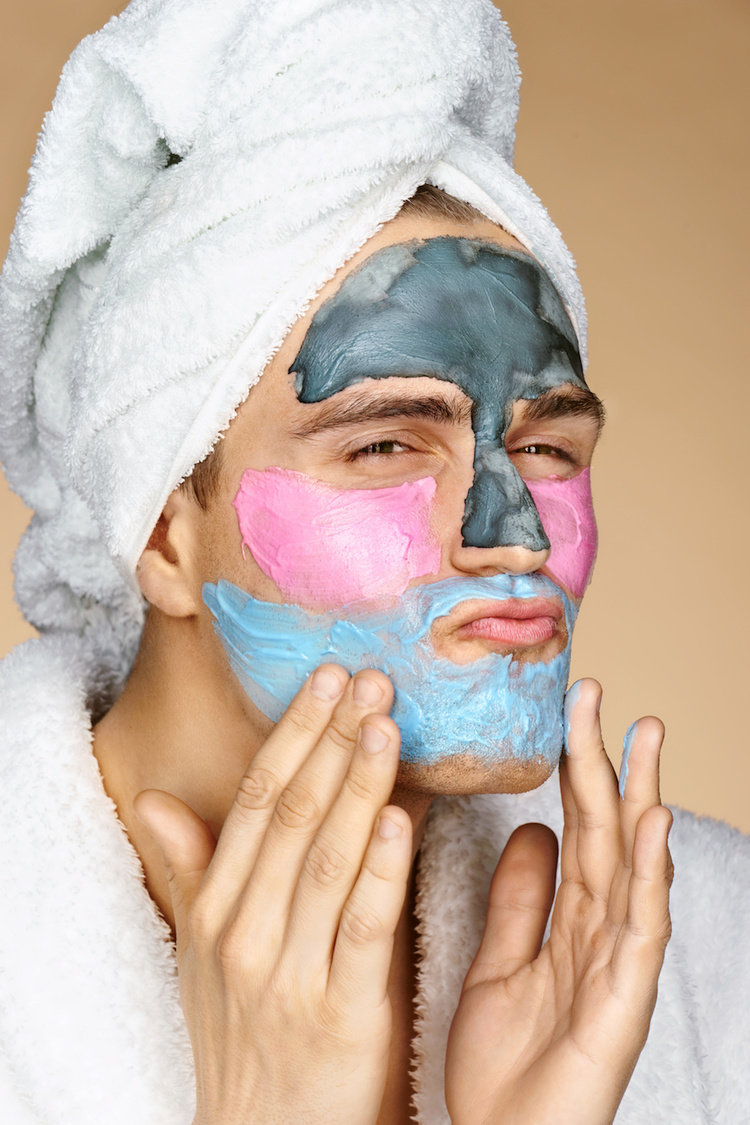 Man wearing 3 different types of face masks for acne treatment