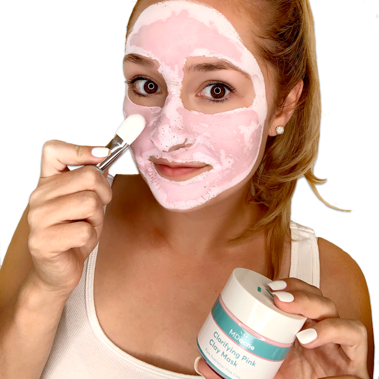 Woman applying MDacne Clarifying Pink Clay Mask with Australian Pink Clay