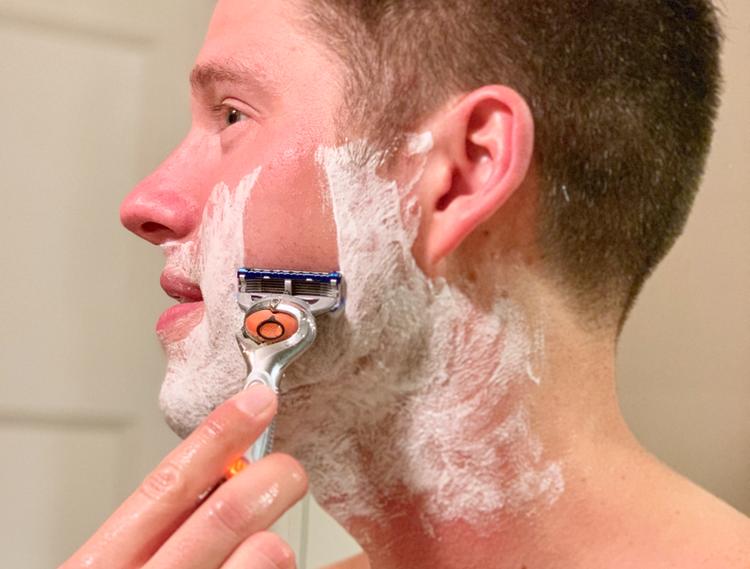 Man shaving with Gilette Mach 3 razor