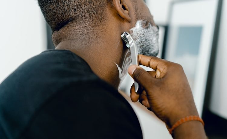 Man shaving with MDacne Soothing Shave Cream